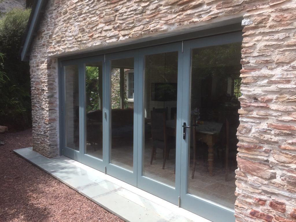 Bi-folding wooden doors